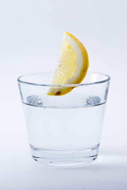 Glass of water and a slice of lemon